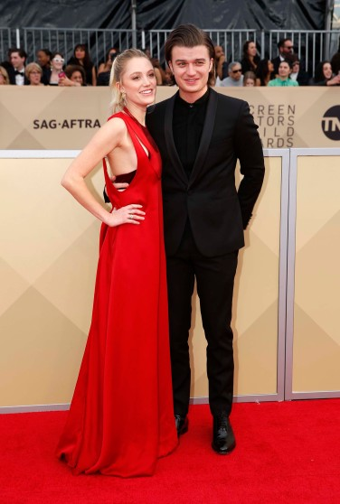 24th Screen Actors Guild Awards – Arrivals – Los Angeles, California, U.S., 21/01/2018 – Actors Maika Monroe and Joe Keery. REUTERS/Monica Almeida
